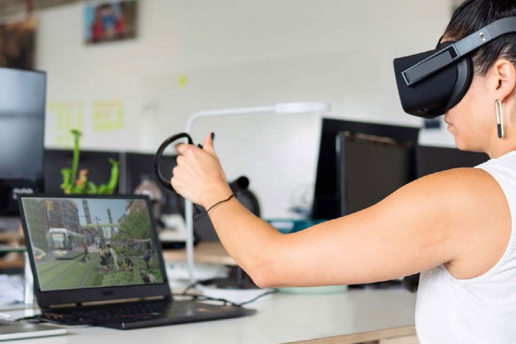 Picture of designer working on city planning using virtual reality tools